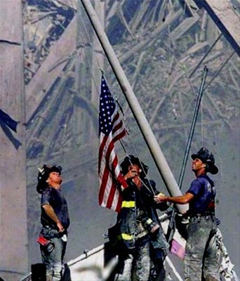 Firefighters raise the American Flag at Ground Zero